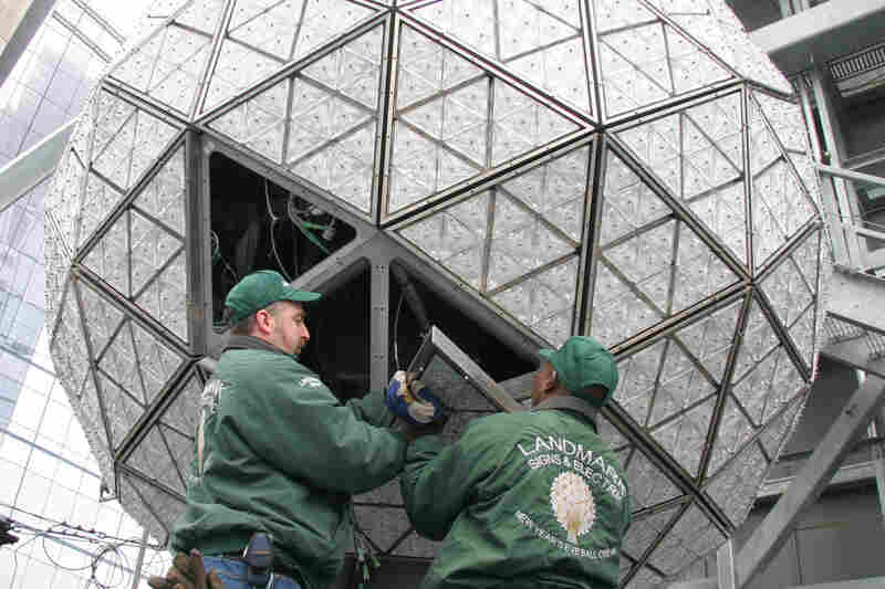 Technicians install some of the 2,668 Waterford Crystal triangles on the 2009 ball.