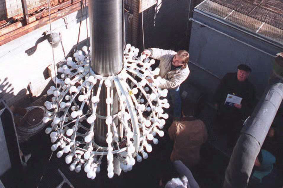 Technicians replace bulbs on the ball. This was the last appearance of the ball in this form before it was upgraded with aluminum skin and rhinestones in 1995.