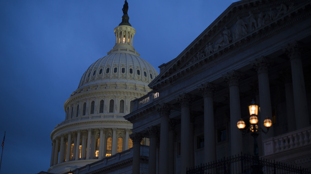 The Capitol is illuminated in Washington, where the House and Senate remain in session. The two chambers will miss a deadline to avoid the