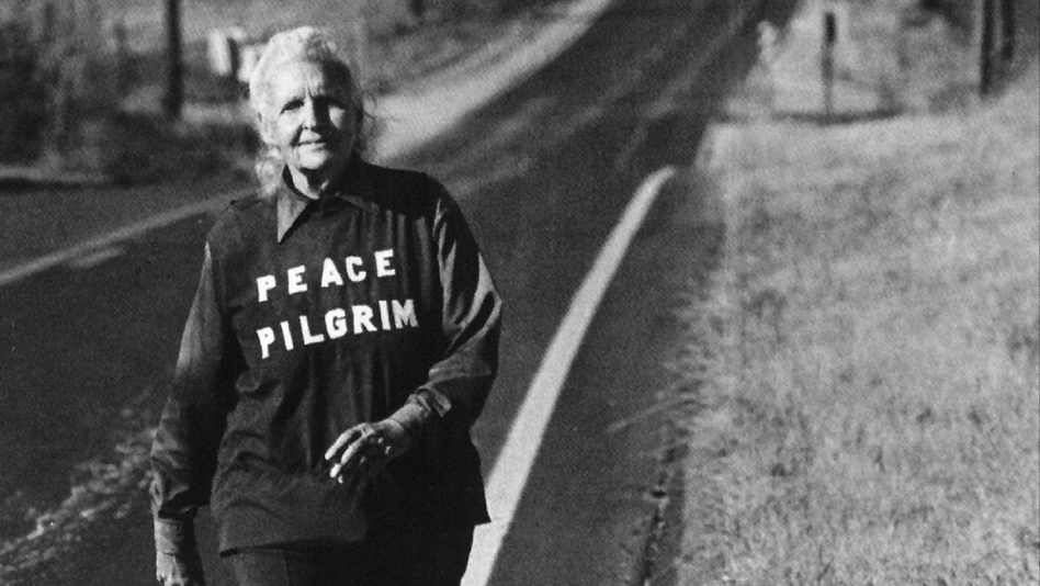 Peace Pilgrim near Topeka, Kan., in the late 1970s. She had walked 25,000 miles by 1964, and continued for almost two more decades. She carried only a pen, a comb, a toothbrush and a map. (Courtesy of Friends Of Peace Pilgrim)