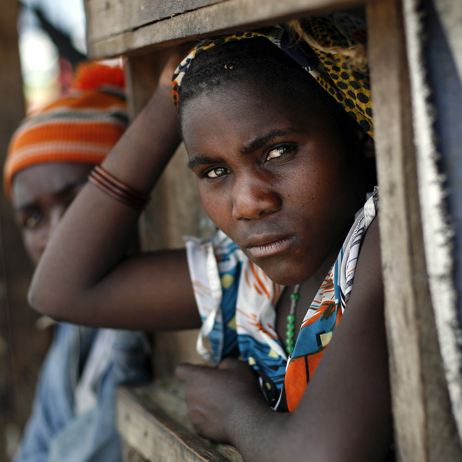 A Congolese woman waits for food to be distributed at the Mugunga III camp for displaced people outside the eastern town of Goma, Dec. 2.