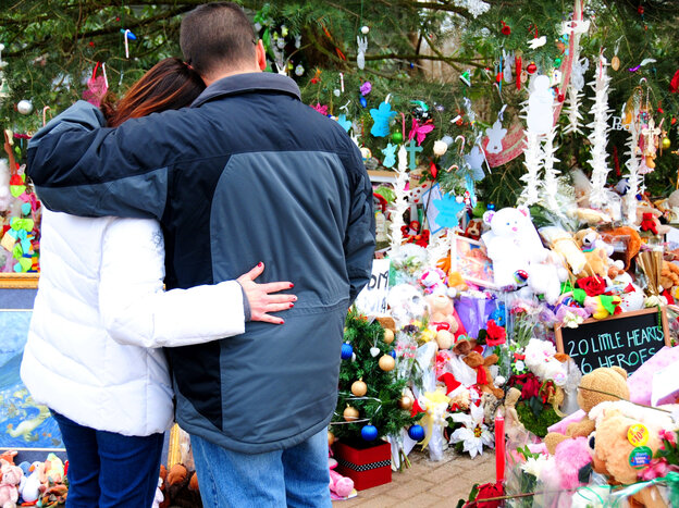 Remembering the victims: Earlier this month, two mourners paused at a makeshift memorial in Newtown, Conn., for the children and adults killed at Sandy Hook Elementary School.