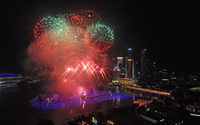 Fireworks illuminate the sky over the Marina Bay in Singapore during an eight-minute display.