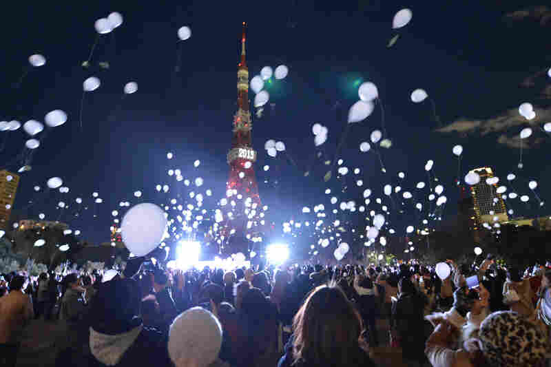 People release balloons during an annual ceremony produced by the Prince Park Tower hotel in Tokyo. More than 1,000 balloons were released, along with visitor's wishes.