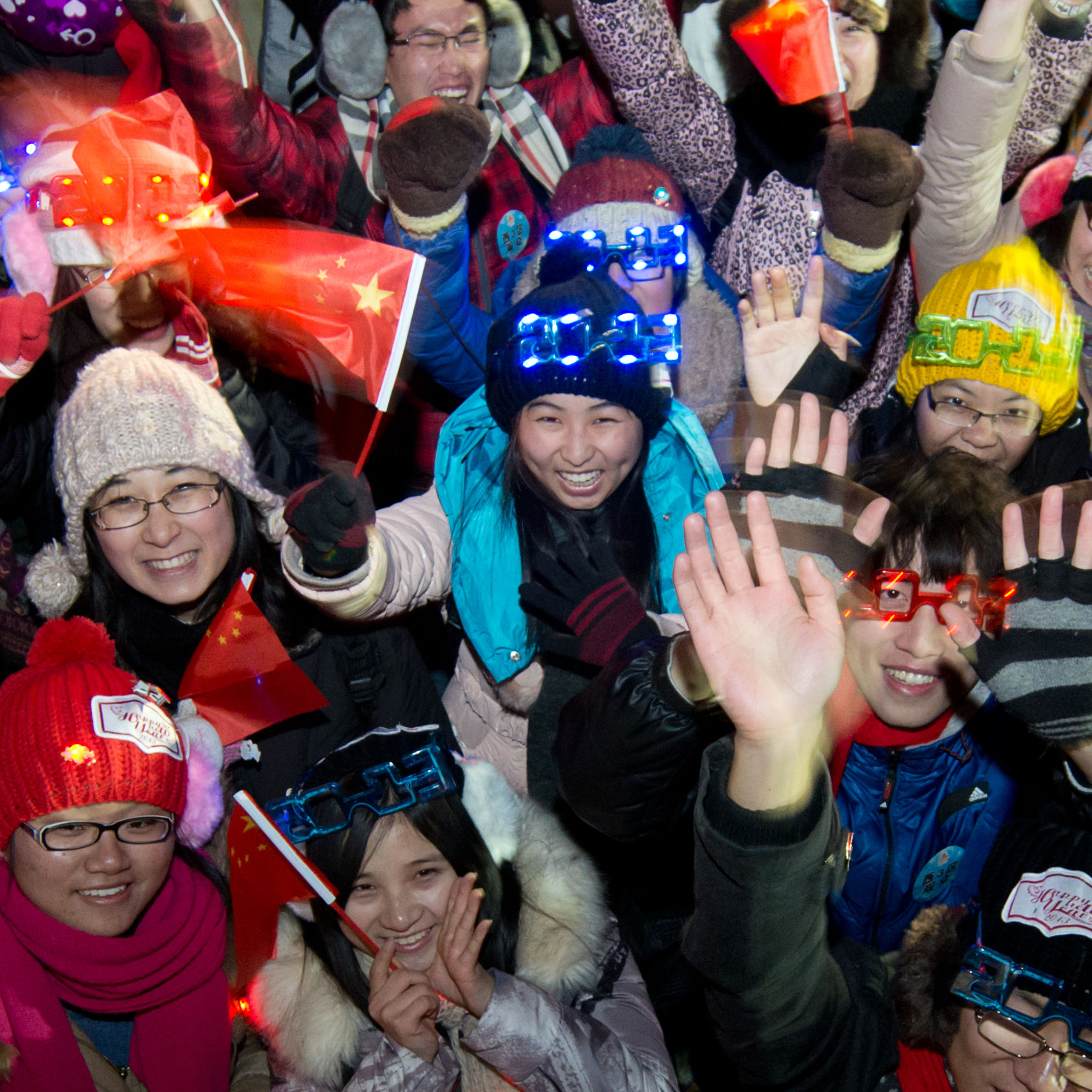 People celebrate the new year following a count-down event at the Summer Palace in Beijing.