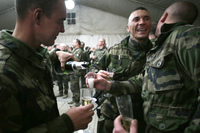French soldiers celebrate the New Year's Eve at Warehouse base in Kabul.