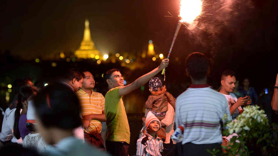 Revelers count down to 2013 near the Shwedagon Pagoda in Yangon, Myanmar, where thousands gathered for the city's first public countdown to the New