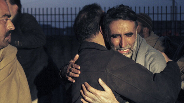 A father of an aid worker, who was killed by gunmen, mourns the death of his daughter at a hospital in Swabi, Pakistan on Tuesday.