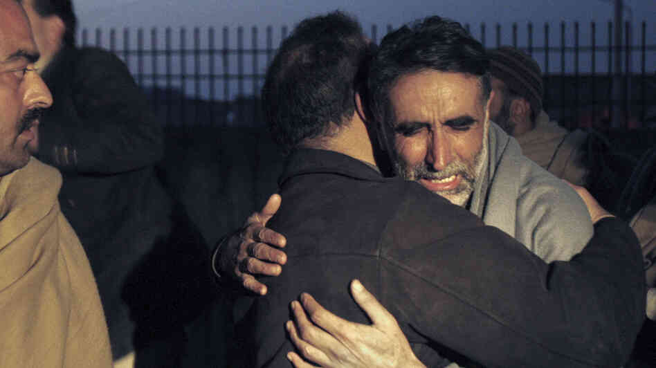 A father of an aid worker, who was killed by gunmen, mourns the death of his daughter at a hospital in Swabi, Pakistan
