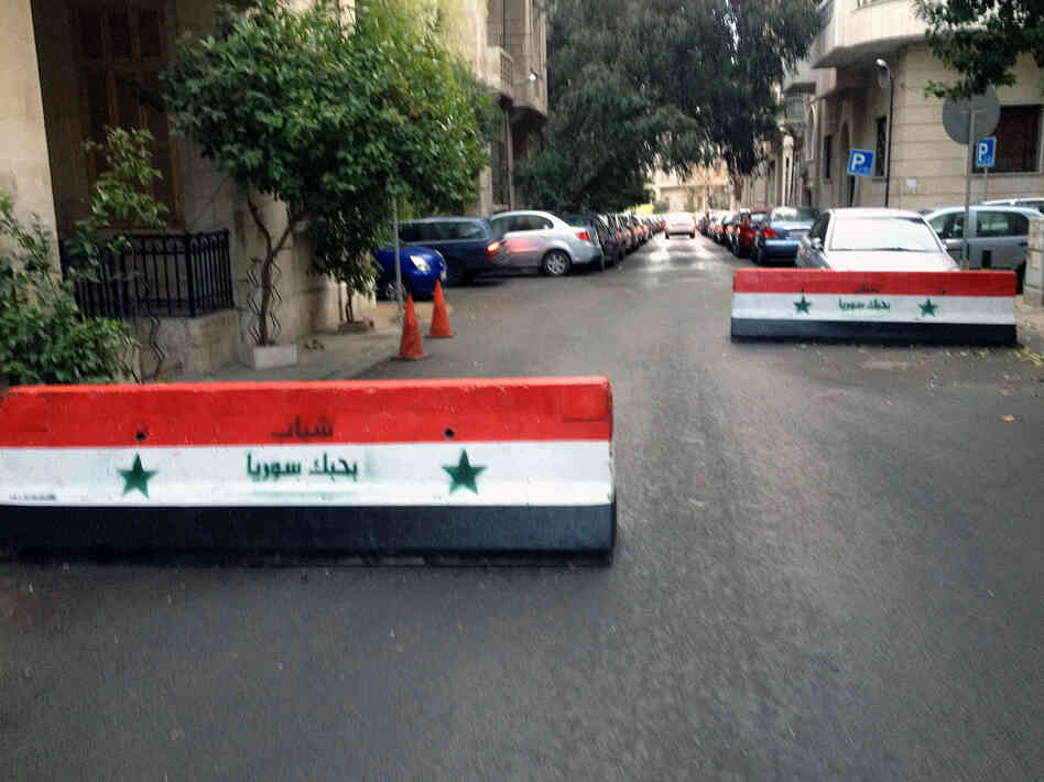 Regime barricades block a street in Damascus, Syria, on New Year's Eve.