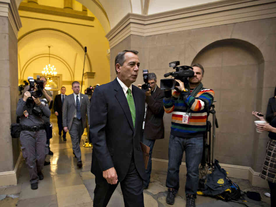House Speaker John Boehner of Ohio arrives on Capitol Hill on Tuesday as legislation to negate a fiscal cliff of across-the-board tax increases and sweeping spending cuts moves to the GOP-dominated House.