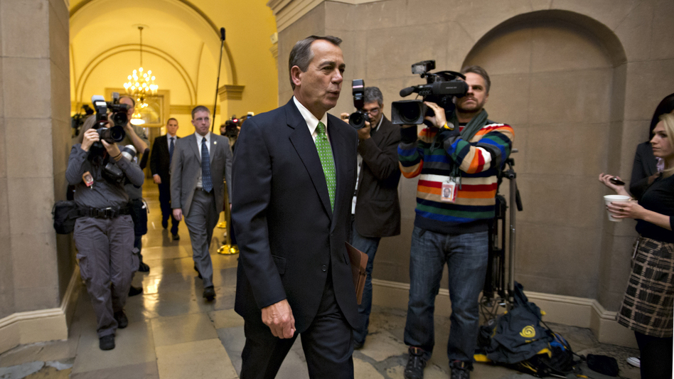 House Speaker John Boehner of Ohio arrives on Capitol Hill on Tuesday as legislation to negate a fiscal cliff of across-the-board tax increases and sweeping spending cuts moves to the GOP-dominated House. (AP)