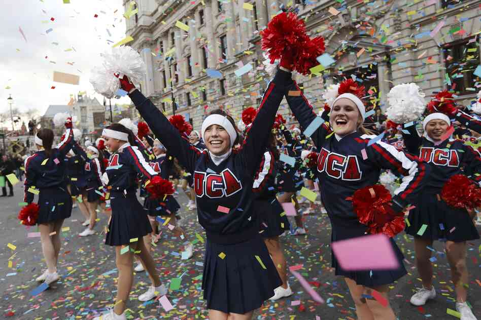 Cheerleaders take part in the New Year's Day parade in central London on January 1, 2013.