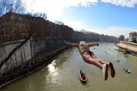 Maurizio Palmulli of Italy dives into Rome's Tiber River, continuing an annual tradition which dates back to 1946.