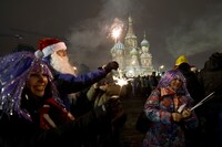 People celebrate the New Year in front of St. Basil's Cathedral on Moscow's Red Square.
