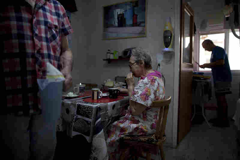 Bella Perlin (center) and Avraham Shapiro (left), Belarusian immigrants, eat breakfast at their home in Hadera, northern Israel. They moved to Israel in 1991 at the height of the wave of immigration from the former Soviet Union.