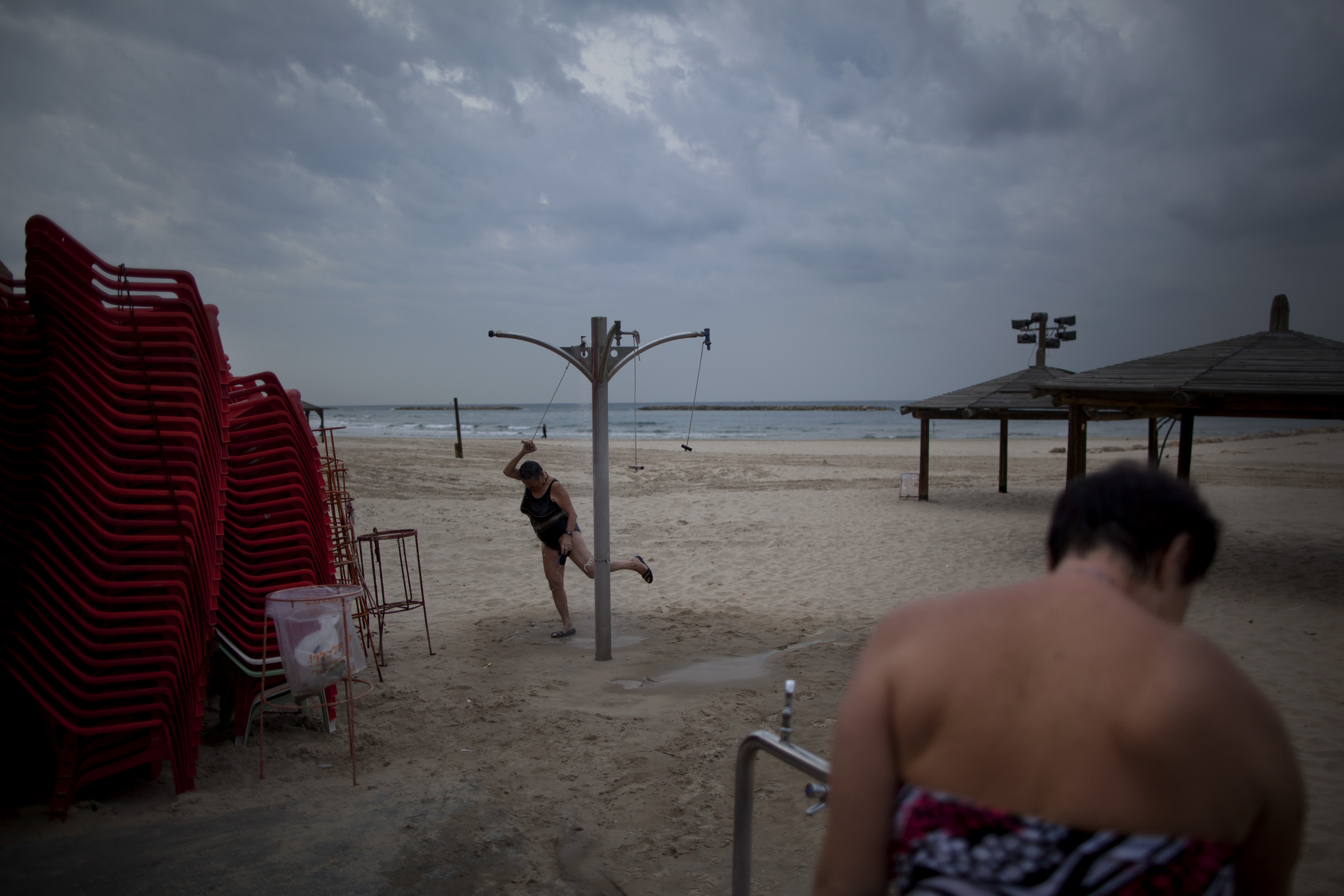 Two immigrants from the Ural region of the former Soviet Union rinse off after bathing in the Mediterranean Sea on an early December morning in Tel Aviv. Many Soviet immigrants gather at the beach for a traditional winter dip, the closest substitute to the freezing waters of the former Soviet Union.