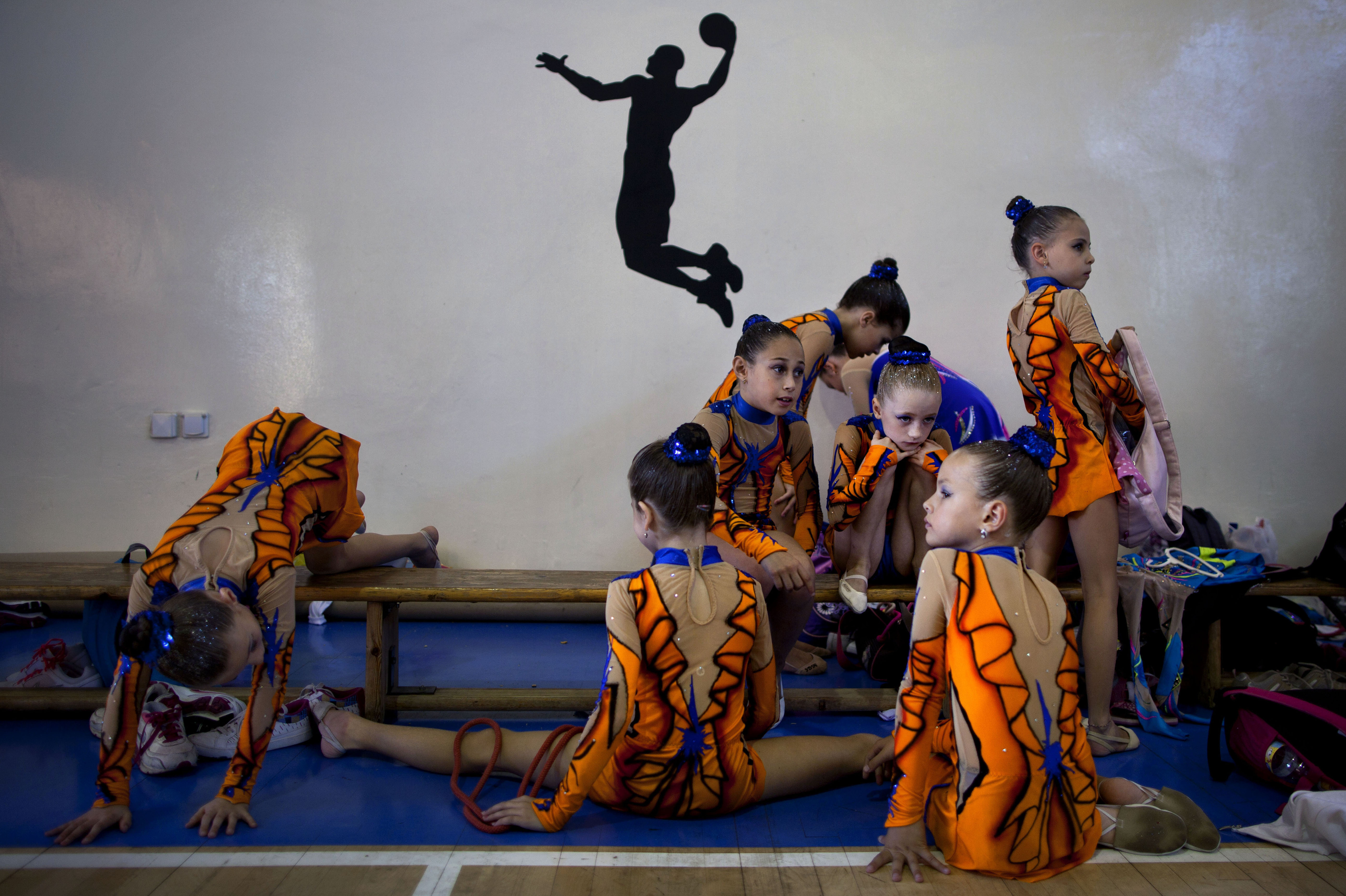 Gymnasts from Russian-speaking immigrant families warm up at a gymnastics competition organized for Israel's immigrant community, in the southern resort city of Eilat. Most of Israel's Olympic gymnasts are immigrants from the former Soviet Union.
