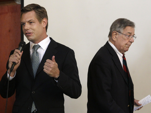 Then-candidate Eric Swalwell speaks as Rep. Pete Stark, D-Calif., walks offstage during an endorsement meeting at the Alameda County Democratic Lawyers Club in Oakland, Calif., in September.