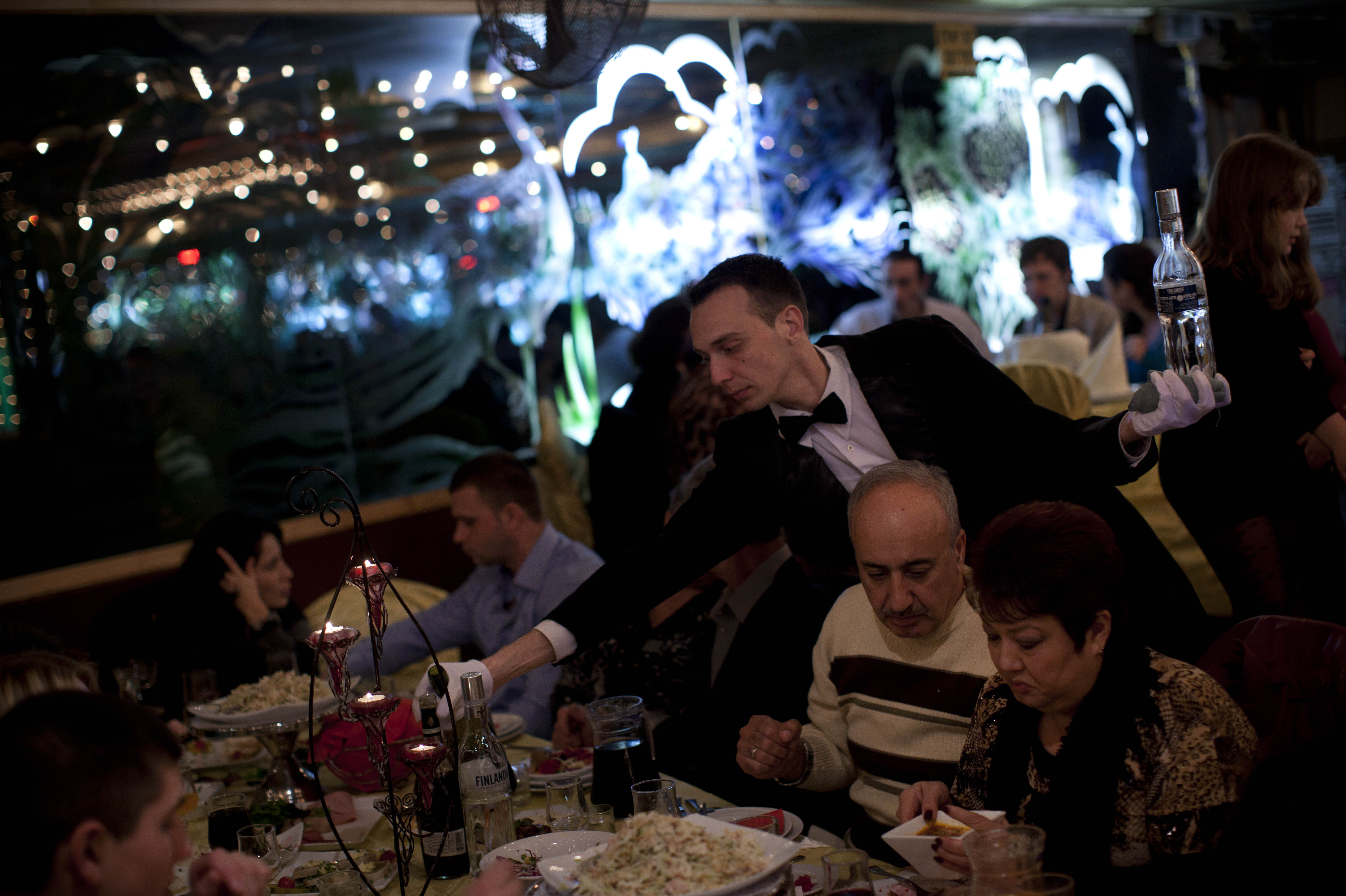 A waiter serves traditional Russian food at a seaside restaurant in Ashdod, a southern Israeli city heavily populated by immigrants from the former Soviet Union.