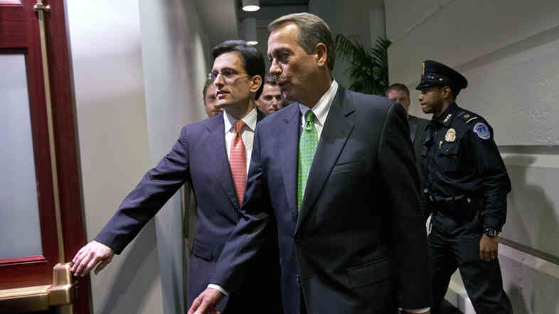 House Speaker John Boehner, R-Ohio (right), and Majority Leader Eric Cantor, R-Va., enter a Republican caucus meeting at the U.S. Capitol on Tuesday.