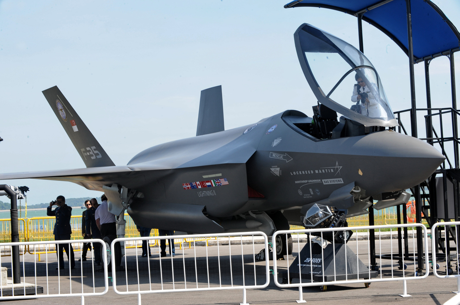 Visitors look at a Lockheed Martin F-35 fighter jet at the Singapore Airshow in 2010. The cost of the plane keeps on rising and is now $130 million or more per plane, depending on the model.