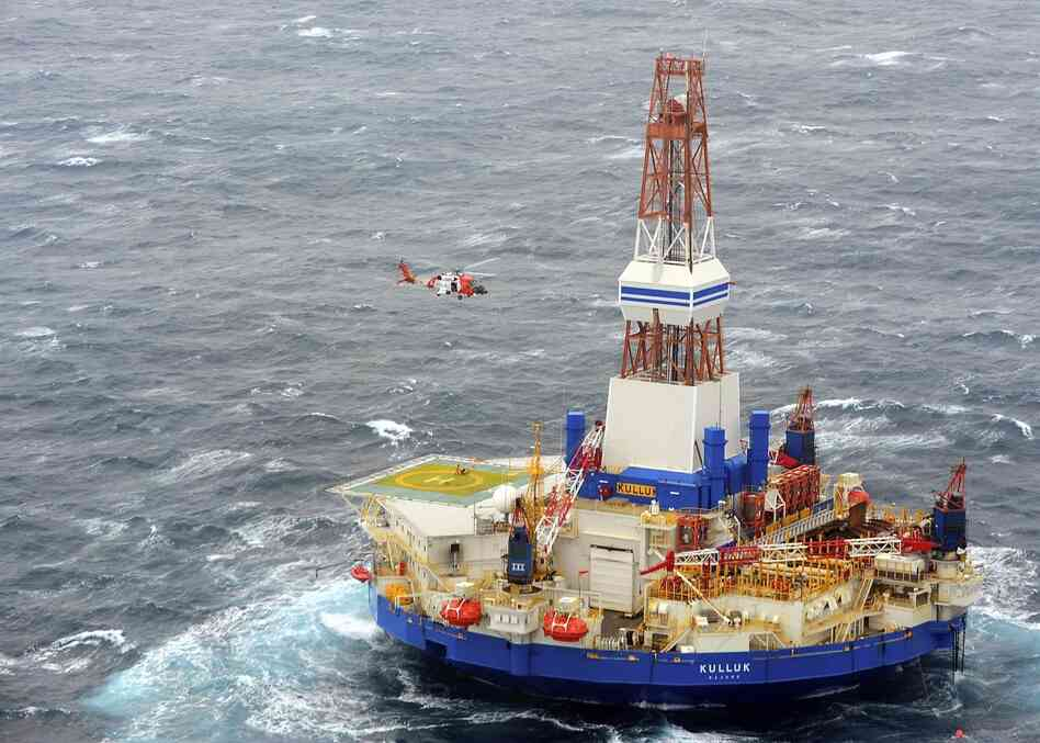 A Coast Guard helicopter crew conducts the 13th hoist of 18 crewmen from the mobile drilling unit Kulluk on Saturday, Dec. 29, 2012, 80 miles southwest of Kodiak City, Alaska. On Monday,
