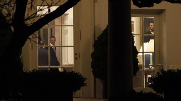 "President Obama was in the Oval Office late Tuesday night as the House finished voting on the ""fiscal cliff"" deal. After praising the passage, he left for Hawaii to resume a vacation with his family. (Getty Images)"