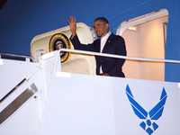 President Barack Obama  steps off Air Force One at Hickam Air Force Base near Honolulu, Hawaii, Wednesday. Obama returned to Hawaii to continue his vacation — prompting questions about how he will sign the fiscal cliff bill.