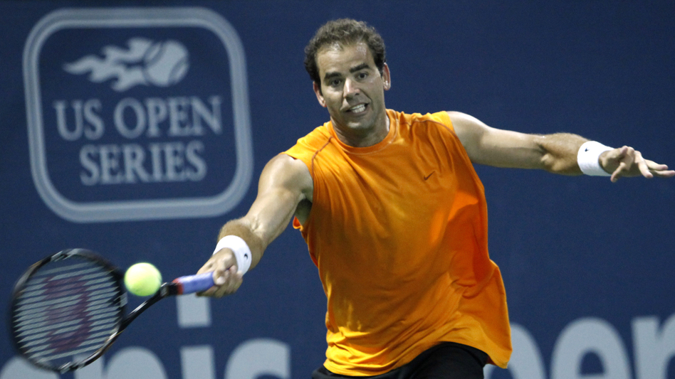 Pete Sampras returns a forehand against Russia's Marat Safin during an exhibition tennis match at the L.A. Tennis Open tournament in 2009. The tournament, which has been around for decades, is now relocating to Colombia as America's dominance in the sport declines and global appeal surges. (AP )