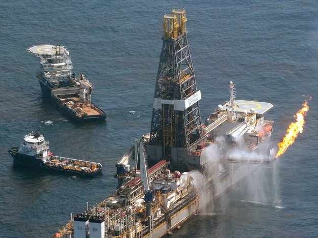 The Transocean Discoverer Enterprise drill ship collects oil from the site of the Deepwater Horizon oil well as workers try to stem the flow of the spill in the Gulf of Mexico, June 12, 2010.
