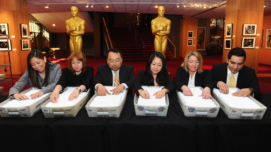 Accountants from PricewaterhouseCoopers prepare ballots for last year's Oscars mailing. Glitches in a new online voting system have prompted organizers to push back this year's balloting deadline. (Getty Images)