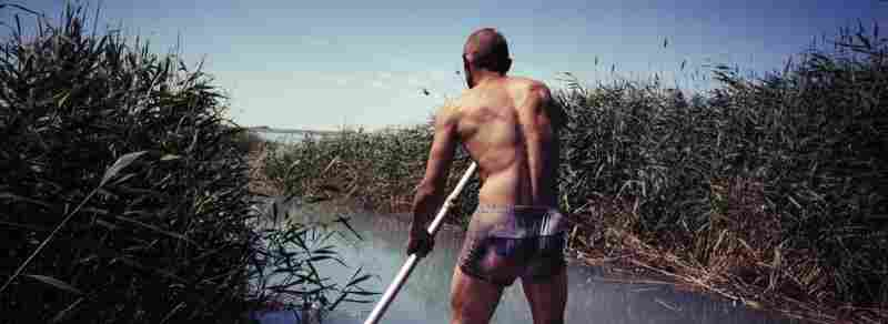 Vasily Sokolov steers his boat, July 2011. Vasily has been making a living mainly by fishing while living in the abandoned military barracks in the Sary-Shagan polygon. The Sokolov family is one of a few families living there.