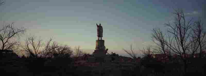 A statue of Vladimir Lenin stands alone in the abandoned military settlement outside Priozersk, Kazakhstan, June 2011. There were some residential buildings around the statue, but all of the residents left the small military settlement after the Soviet collapse.