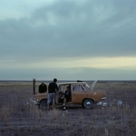 Tanya Sokolov and her friends try to fix a car on the steppe outside the city of Priozersk in the Sary-Shagan polygon, a former site for Soviet ballistic-missile testing in Kazakhstan, 2011. Tanya and her family live in an abandoned military barracks outside the city.