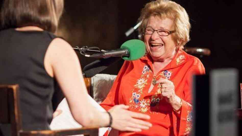 Host Ophira Eisenberg chats with this week's Ask Me Another Very Important Puzzler, Dr. Ruth Westheimer, on stage at The Bell House in Brooklyn, N.Y.