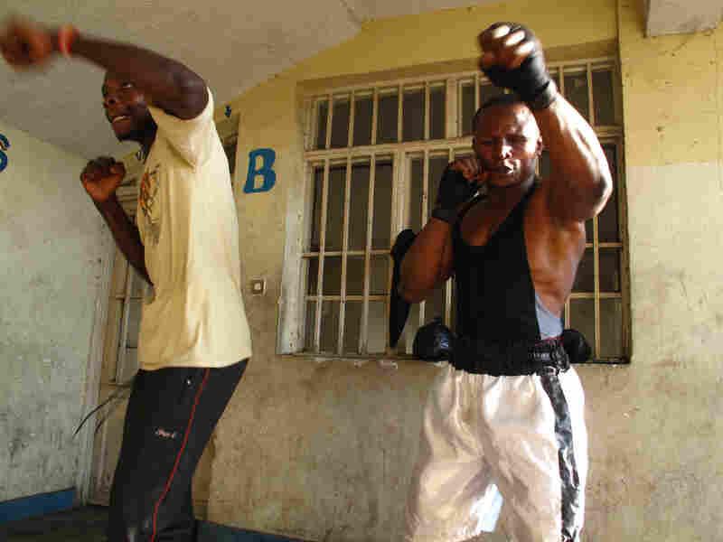 Kibomango trains with former child soldier Fabrice Djef.