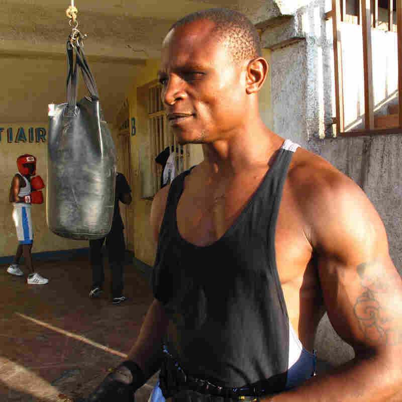 "Balezi Bagunda, who boxes under the name ""Kibomango,"" lost one eye while fighting in a rebel militia he joined as a child. Now he trains other former child soldiers and street boys in the art of boxing and automobile mechanics."