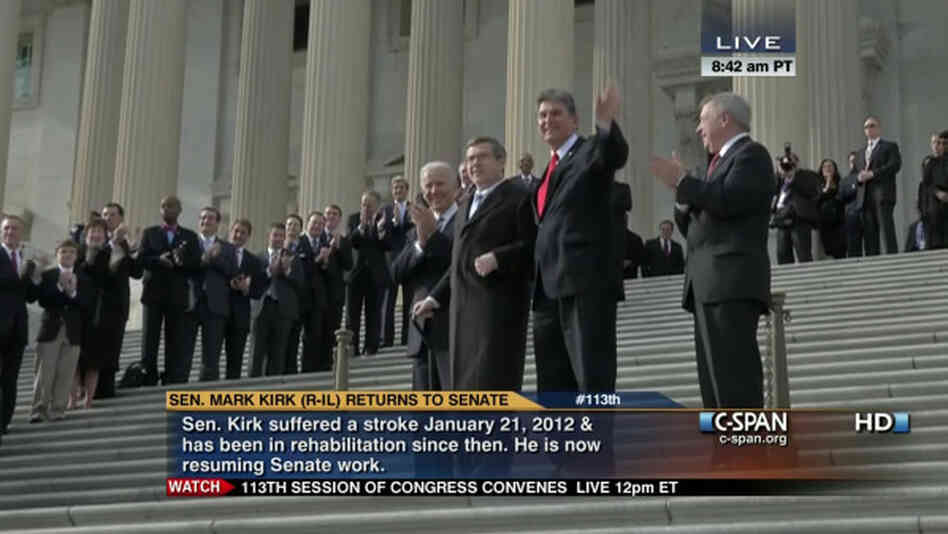 Sen. Mark Kirk, R-Ill., holding a cane. He was helped up the steps of the Capitol by Vice President Biden (behind Kirk) and Sen. Joe Manchin, D-W.Va., (in red tie). Sen. Richard Durbin, D-Ill., is at right.
