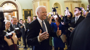 Vice President Joe Biden arrives for a closed-door meeting with Senate Democrats to urge them to support a fiscal cliff deal on Monday.