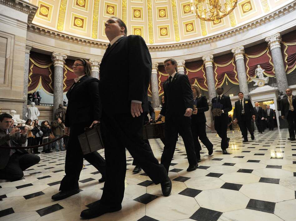 "Senate pages carry the ""certificate of vote"" at the Capitol on Friday. (AFP/Getty Images)"