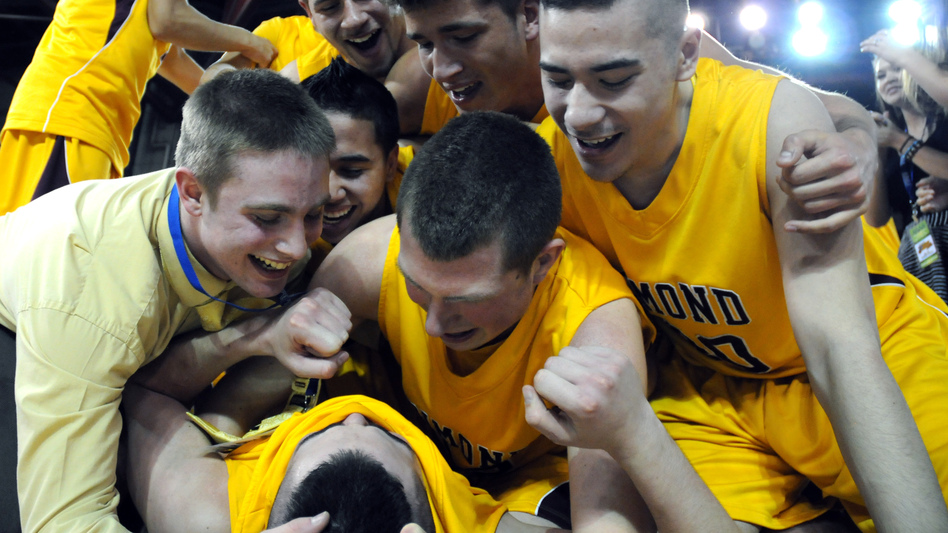Members of the boys basketball team from Dimond High School in Anchorage, Alaska, celebrate their 2012 state championship victory. Psychological research shows that sports camaraderie improves teenagers' mental health. (AP)