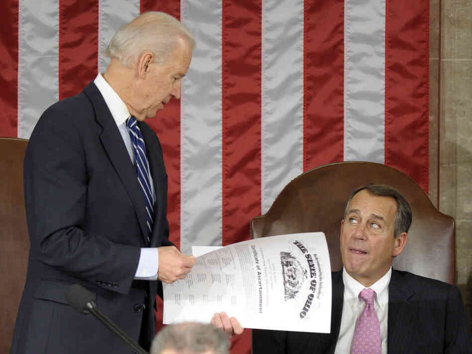 Vice President Joe Biden shows the certificate of the Electoral College vote for Ohio to House Speak