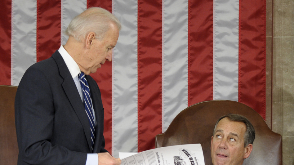 Vice President Joe Biden shows the certificate of the Electoral College vote for Ohio to House Speaker John Boehner during a joint session of Congress on Friday. (AP)
