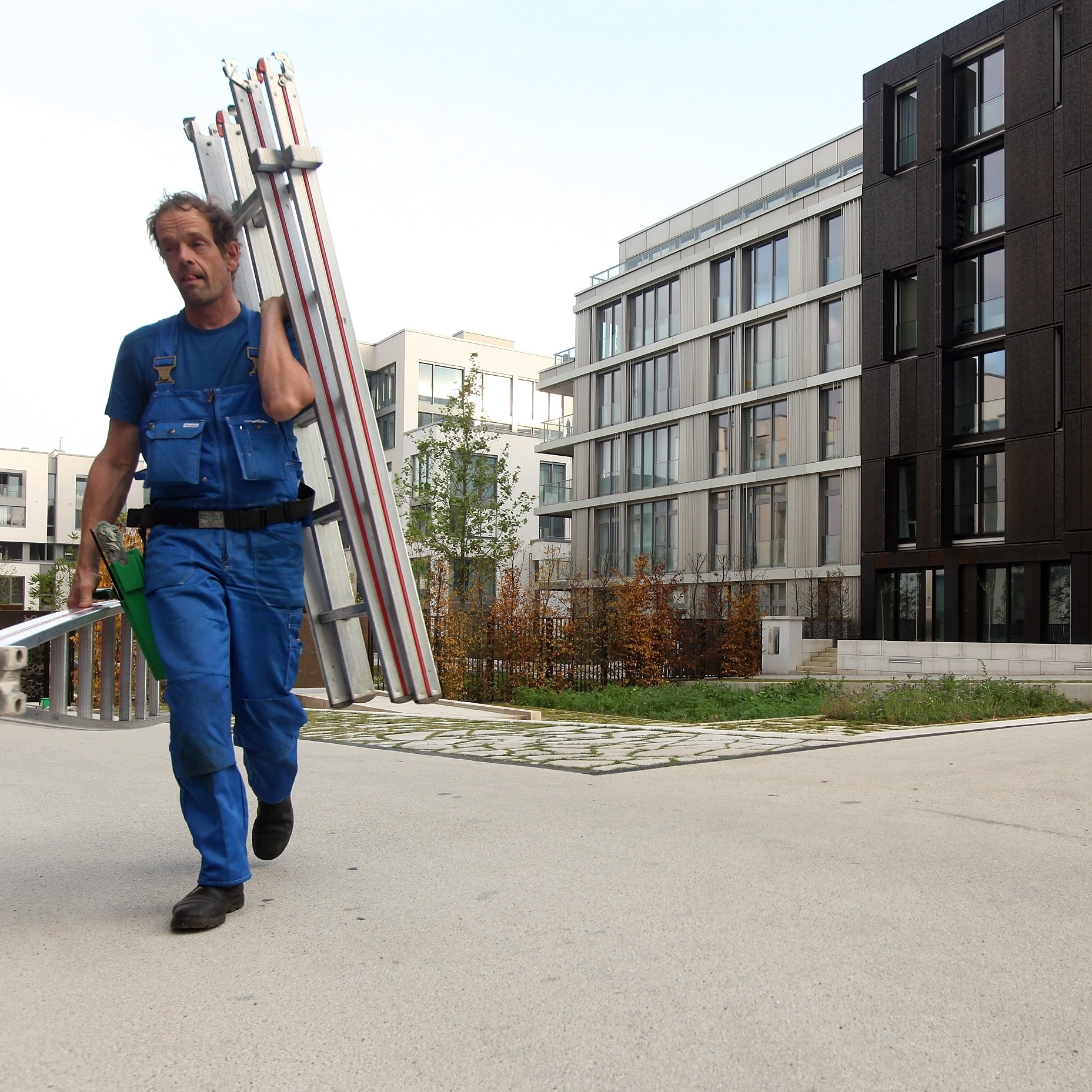 A worker walks through a new housing complex in Berlin. German and foreign investors are rapidly buying up property, leaving some analysts concerned about a potential housing bubble.