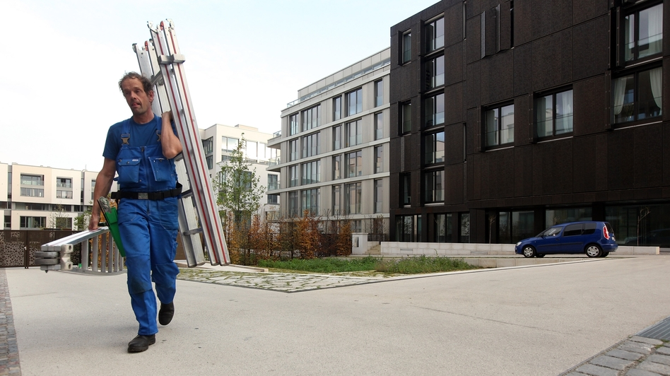 A worker walks through a new housing complex in Berlin. German and foreign investors are rapidly buying up property, leaving some analysts concerned about a potential housing bubble. (Getty Images)