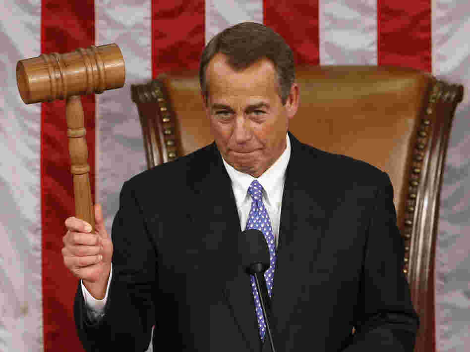 House Speaker John Boehner holds up the gavel after being re-elected on the first day of the 113th Congress.