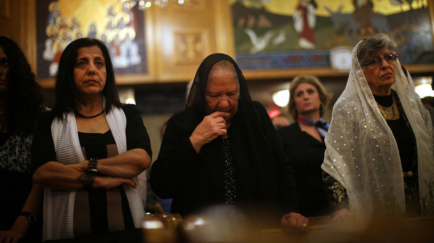 Egyptian Coptic Christians celebrate Christmas Nativity Liturgy, the start of Christmas, at the Coptic Orthodox Church of St. George in Brooklyn last January. (Getty Images)