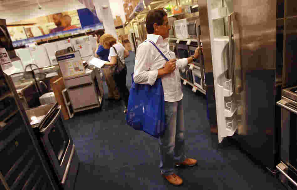 Ruben Fragoso checks out appliances at Best Buy in Miami in April 2010, when Florida residents were taking advantage of a federally funded discount for Energy Star-rated appliances. Legislation just passed by Congress as part of the fiscal-cliff deal includes tax breaks for energy-efficient appliances.