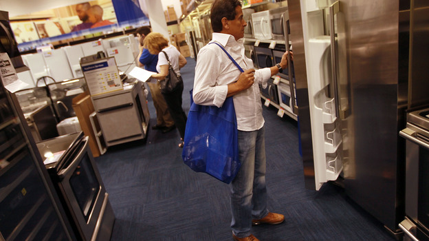 Ruben Fragoso checks out appliances at Best Buy in Miami in April 2010, when Florida residents were taking advantage of a federally funded discount for Energy Star-rated appliances. Legislation just passed by Congress as part of the fiscal-cliff deal includes tax breaks for energy-efficient appliances. (Getty Images)